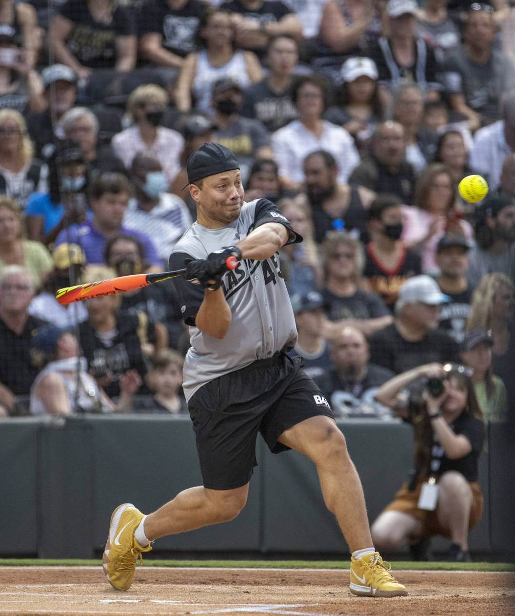Las Vegas Raiders Alec Ingold (45) eyes a pitch while hitting during a charity softball game ve ...