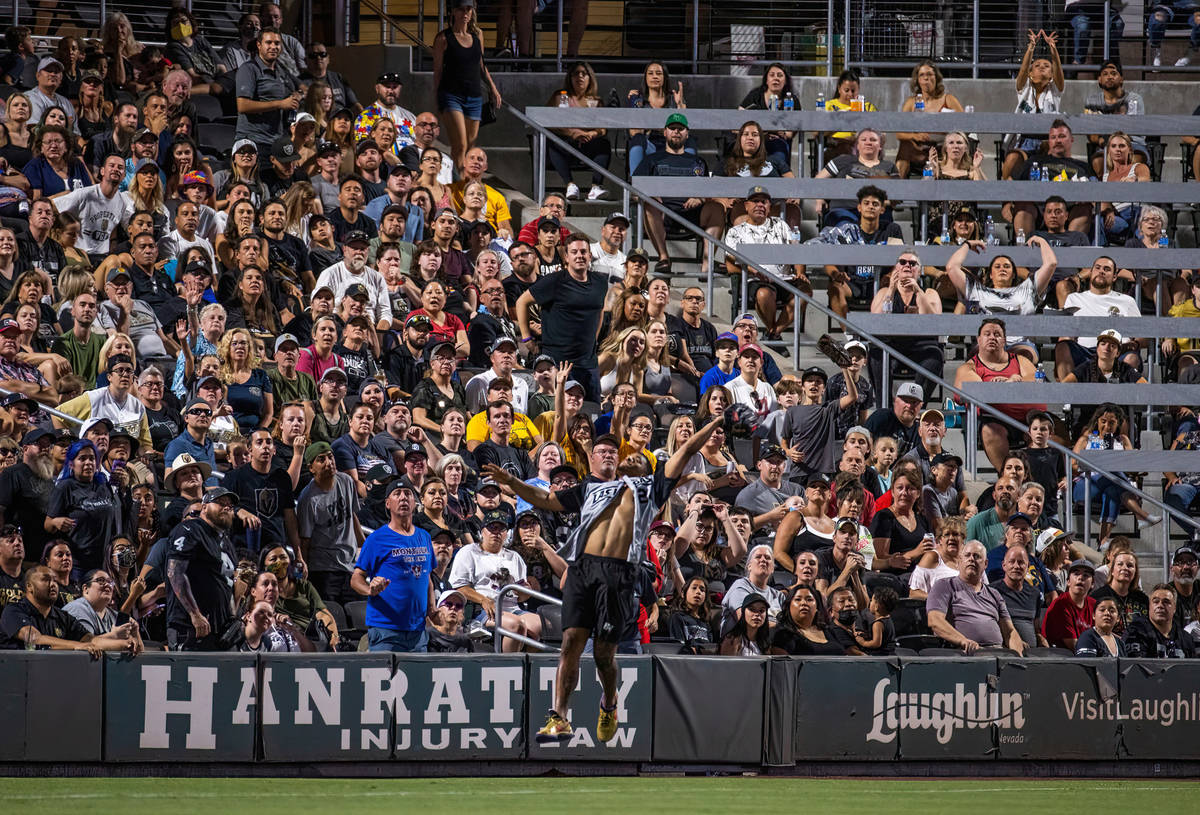 Las Vegas Raiders Johnathan Abram (24) goes up for a fly ball before the crowd during a charity ...