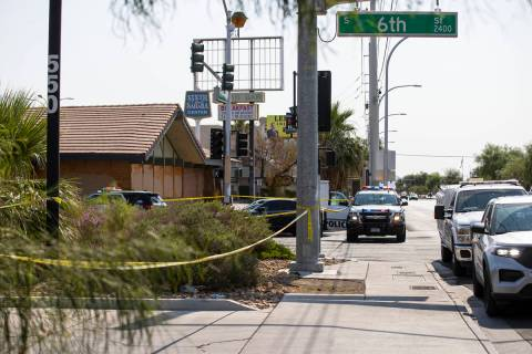 Las Vegas police, with the assistance of animal control, investigate the scene where a dog was ...