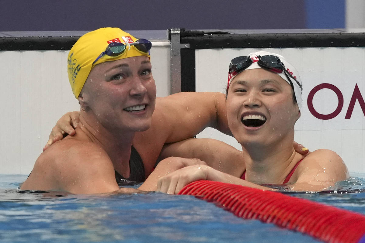 Margaret MacNeil, right, of Canada, is congratulated by Sarah Sjoestroem of Sweden103 aft  triumph   ...
