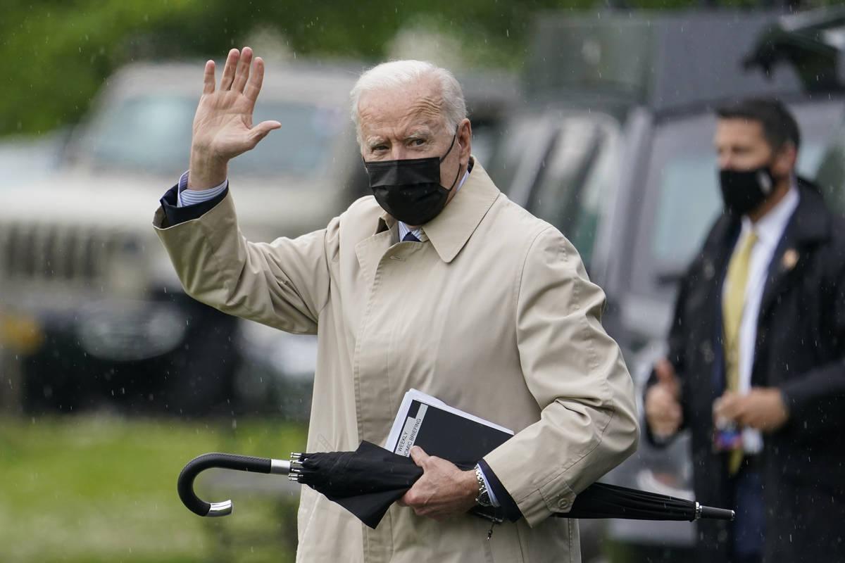 President Joe Biden waves as he walks to Marine One. (AP Photo/Patrick Semansky)