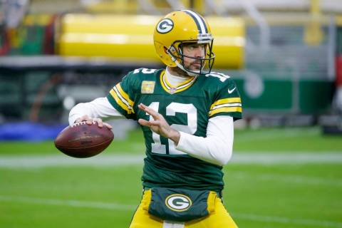 Green Bay Packers' Aaron Rodgers warms up before an NFL football game against the Jacksonville ...