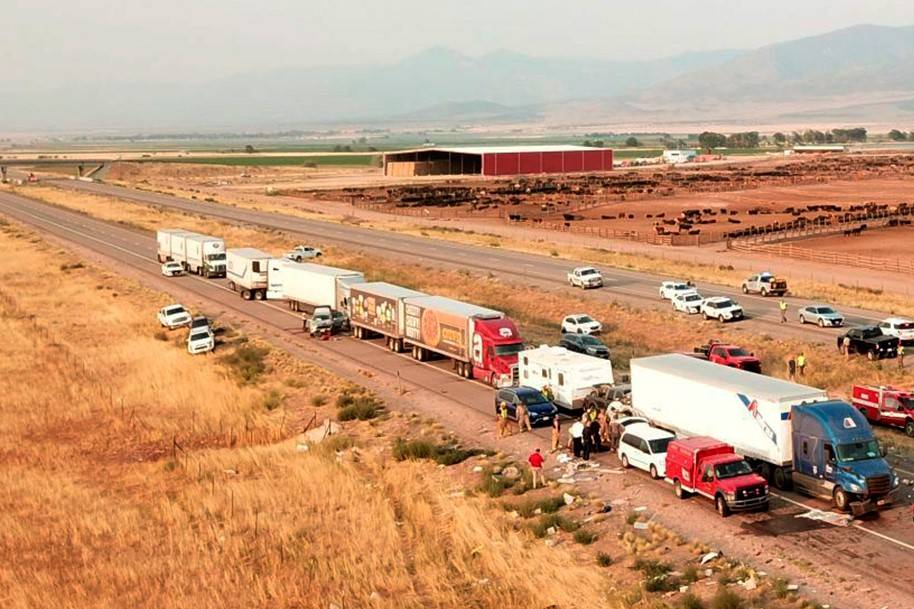 This photo shows the scene of a fatal pileup, Sunday, July 25, 2021, on Interstate 15 in Millar ...