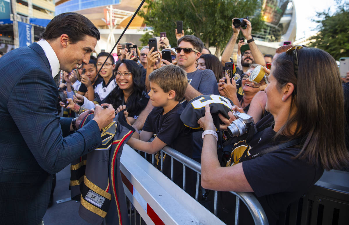 Golden Knights goaltender Marc-Andre Fleury signs an autograph for Lucas Lanfranchi, 9, while w ...