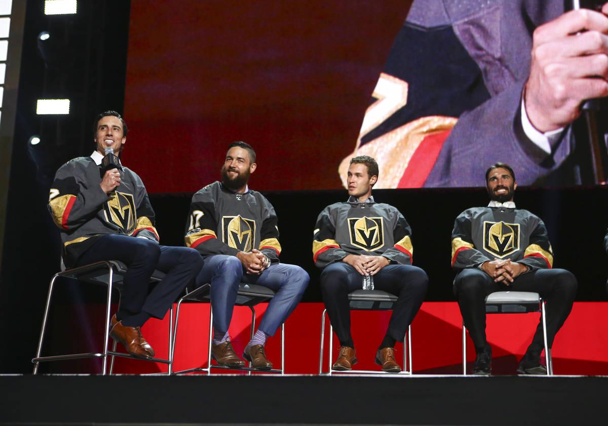 Vegas Golden Knights' Marc-Andre Fleury, left, speaks alongside fellow players Deryk Engelland, ...