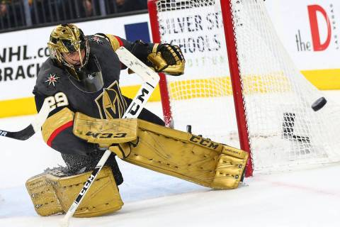Golden Knights goaltender Marc-Andre Fleury (29) blocks a shot from the Arizona Coyotes during ...