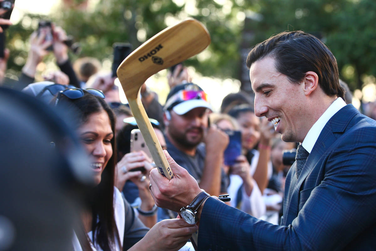 Golden Knights' Marc-Andre Fleury (29) signs autographs on the gold carpet after arriving for t ...