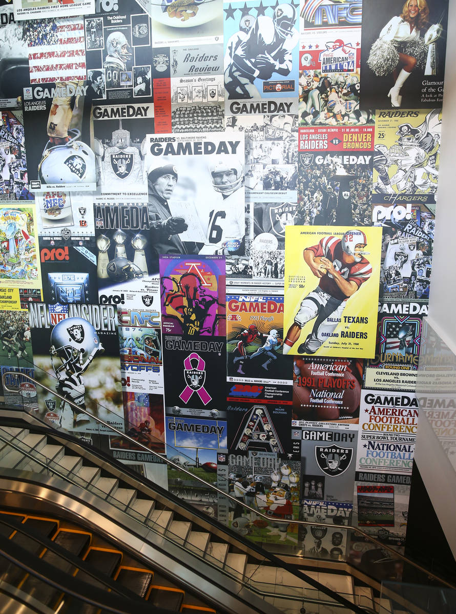 A wall stretching multiple levels highlights Raiders programs as seen during a tour of the Alle ...