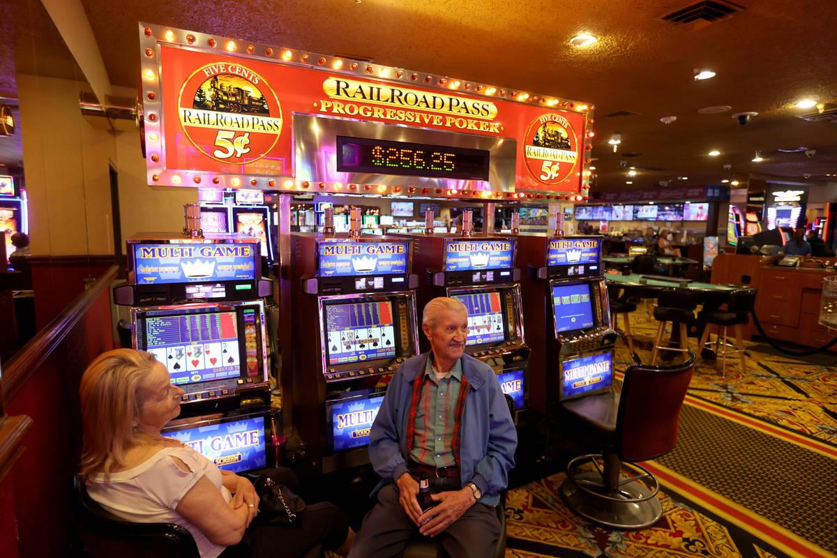 Longtime customers Harry Myrchak, 90, visits with Jan Radunz, both of Boulder City, at Railroad ...