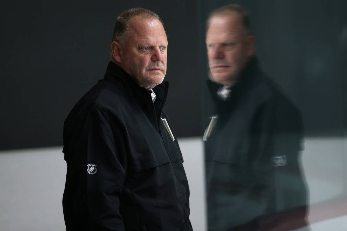 Vegas Golden Knights head coach Gerard Gallant watches players during development camp at City ...