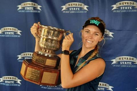 Veronica Joels hoists the trophy after winning the Nevada Women's State Amateur for the third t ...