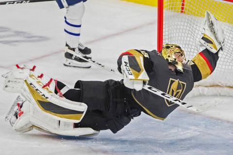 Golden Knights goaltender Marc-Andre Fleury (29) makes a diving save in the third period during ...