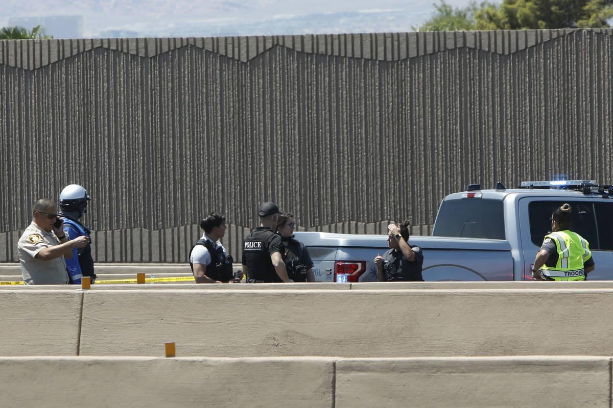 A heavy police presence is seen on Interstate 15 near Sahara Avenue in Las Vegas, Tuesday, July ...