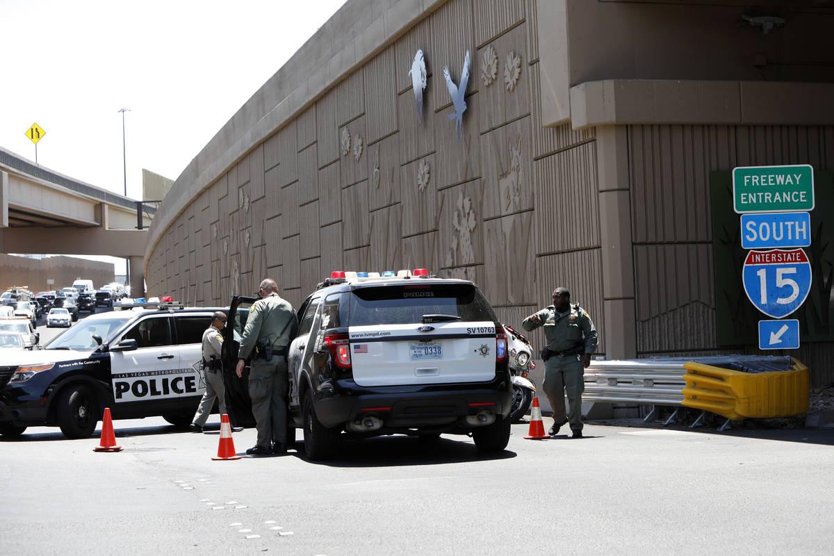Police block Interstate 15 southbound ramp near Charleston Boulevard in Las Vegas, Tuesday, Ju ...
