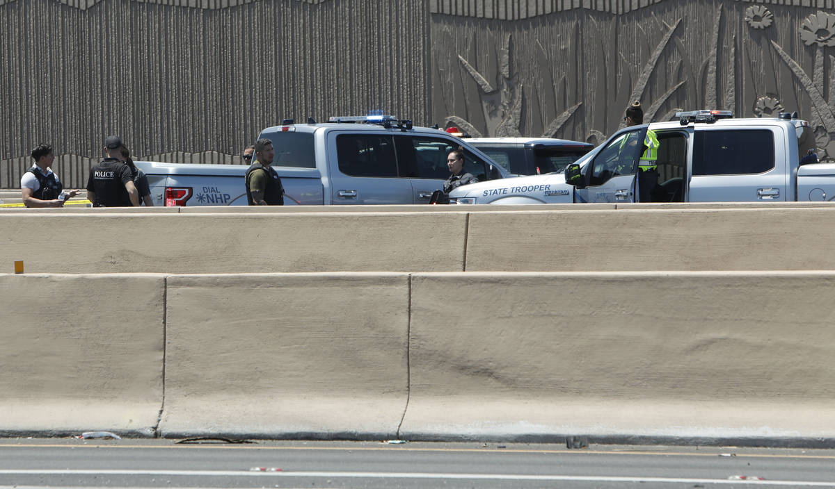 A heavy police presence is visible on Interstate 15 near Sahara Avenue in Las Vegas, Tuesday, J ...