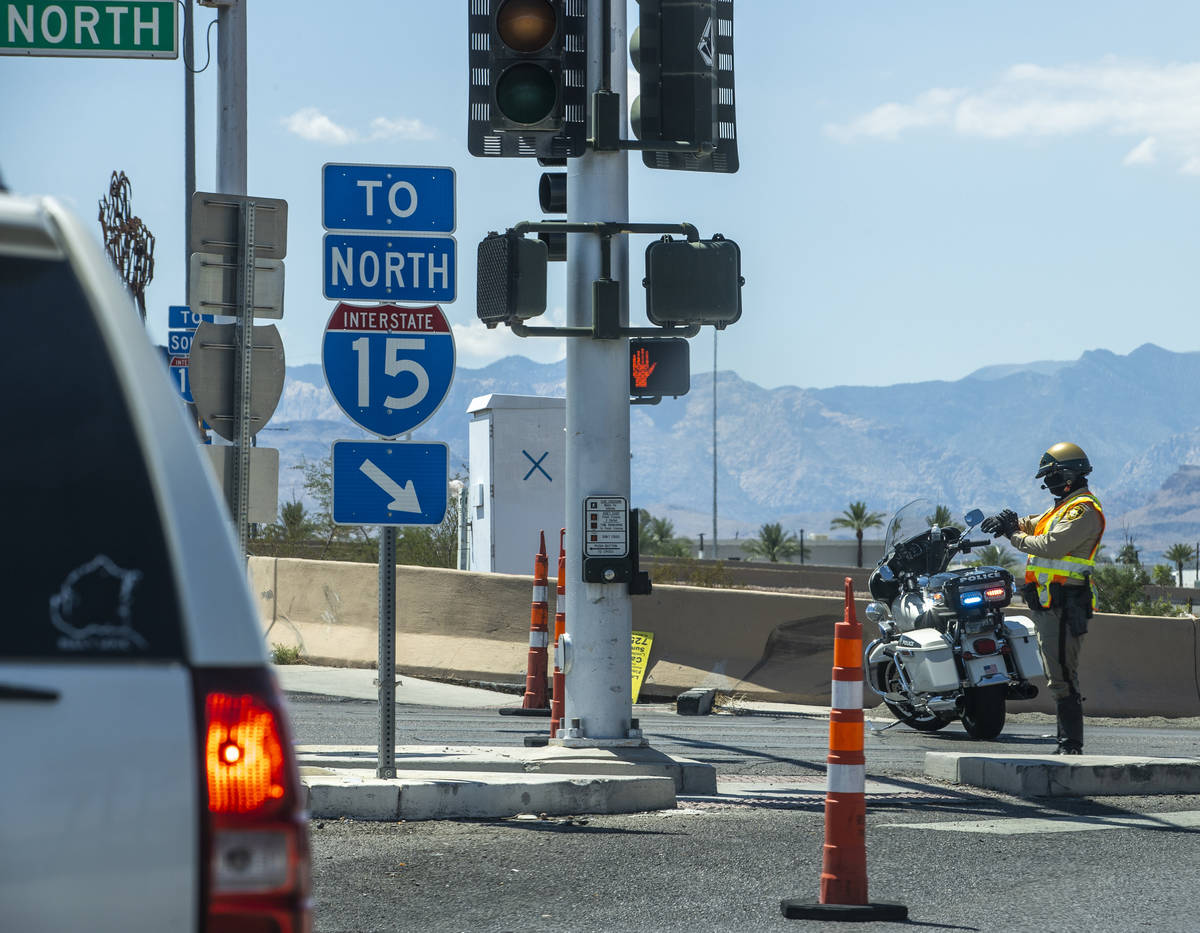 A Metro officer blocks traffic onto the I-15 northbound lanes at Russell Road due to police act ...