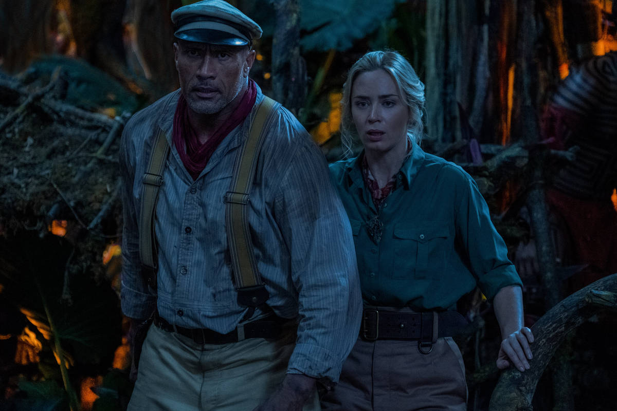 """Dwayne Johnson is Frank Wolff and Emily Blunt is Lily Houghton in Disney's """"Jungle Cruise."""" ( ..."""