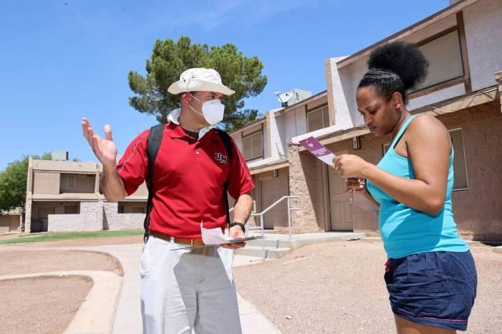 Volunteer Vicente Gomez of Cincinnati, Ohio, left, talks to resident Laquesha Fitch, 30, during ...
