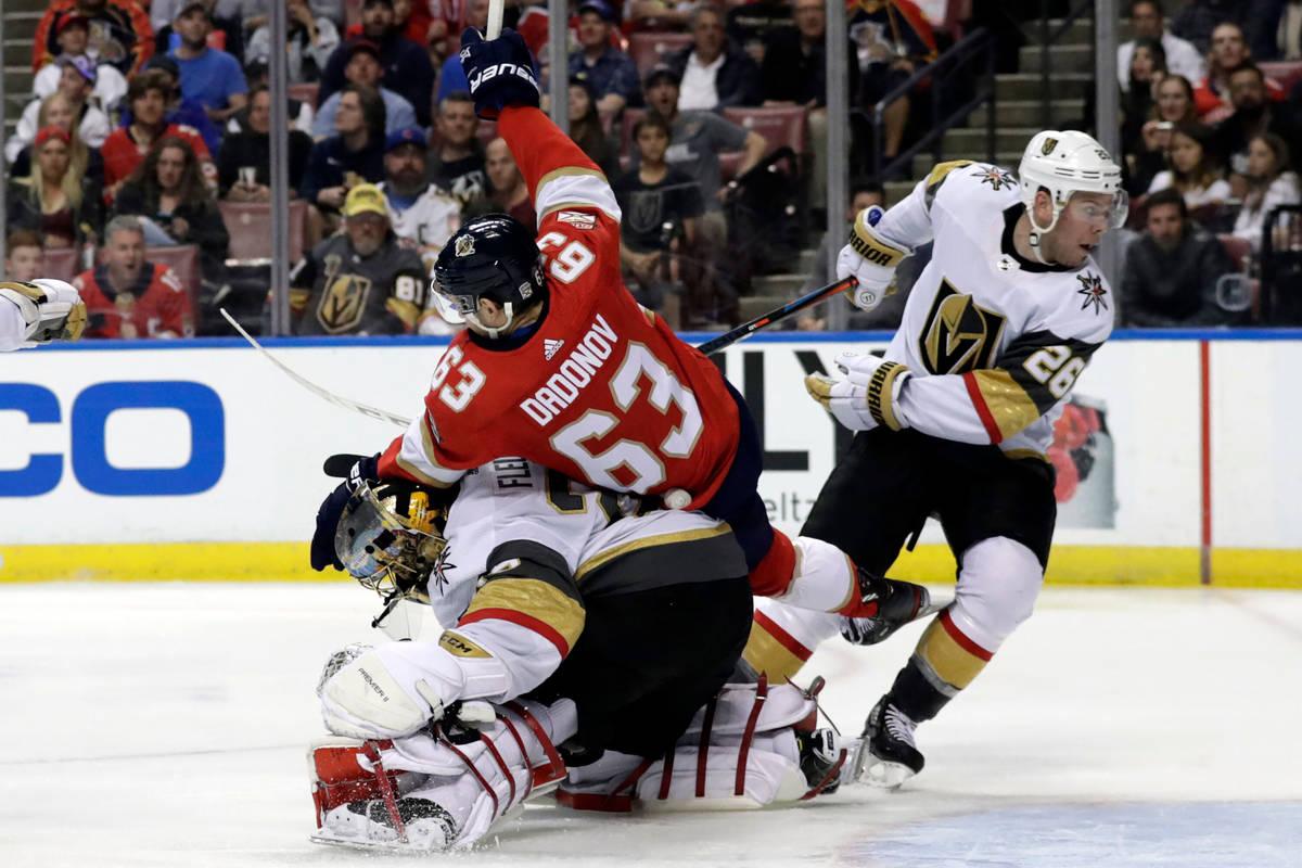 Florida Panthers right wing Evgenii Dadonov (63) collides with Vegas Golden Knights goaltender ...