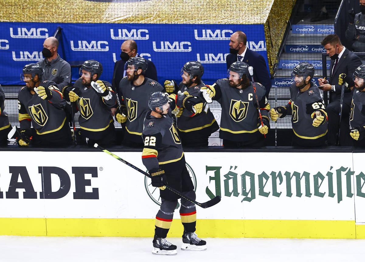Golden Knights' Nick Holden celebrates his goal during the third period of Game 1 of an ...