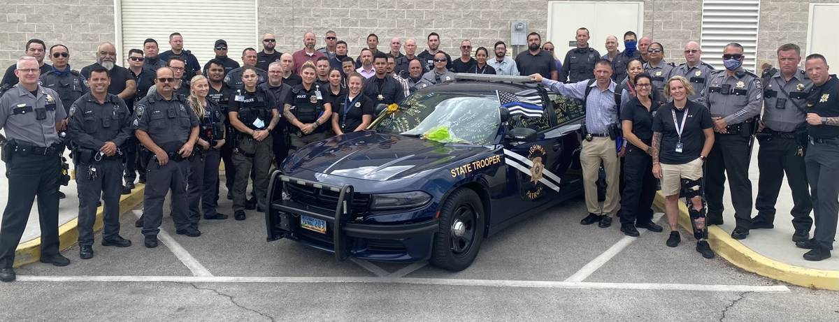 Members of the Nevada Department of Public Safety signed the patrol car of critically injured t ...