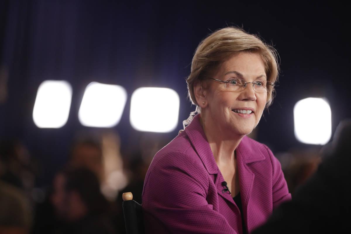 Sen. Elizabeth Warren, D-Mass., talks in the spin room after a Democratic presidential primary ...