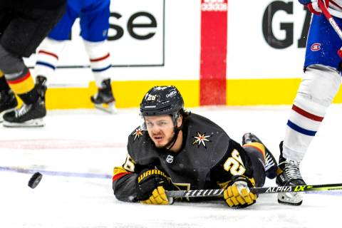 Golden Knights center Mattias Janmark (26) looks to a puck that just gets away on a drive to th ...