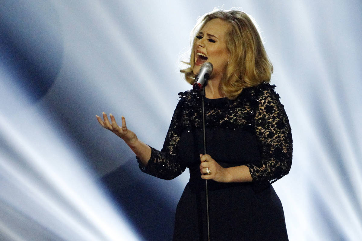 Adele performs during the Brit Awards 2012 at the O2 Arena in London, Tuesday, Feb. 21, 2012. ( ...