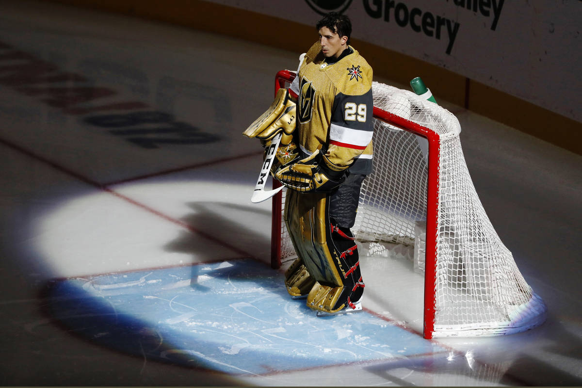 Golden Knights goaltender Marc-Andre Fleury (29) pauses during the National Anthem before the f ...