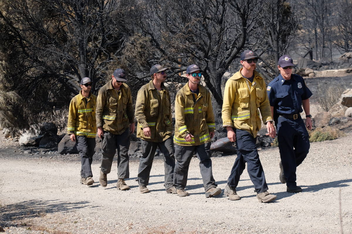 A few of the 1,300 firefighters assigned to containment efforts on 68,000 acre Tamarack Fire. J ...