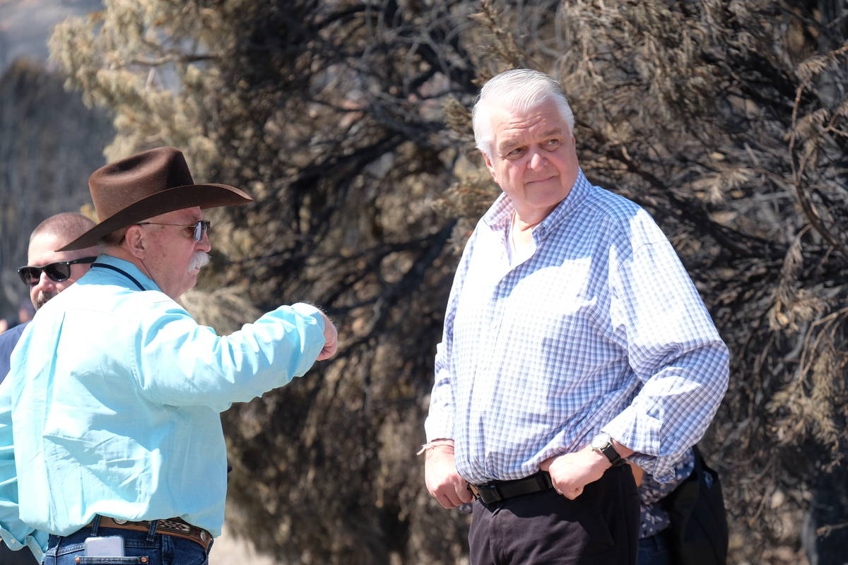 An area resident tells Gov. Steve Sisolak about the 92-year-old woman whose home was destroyed ...