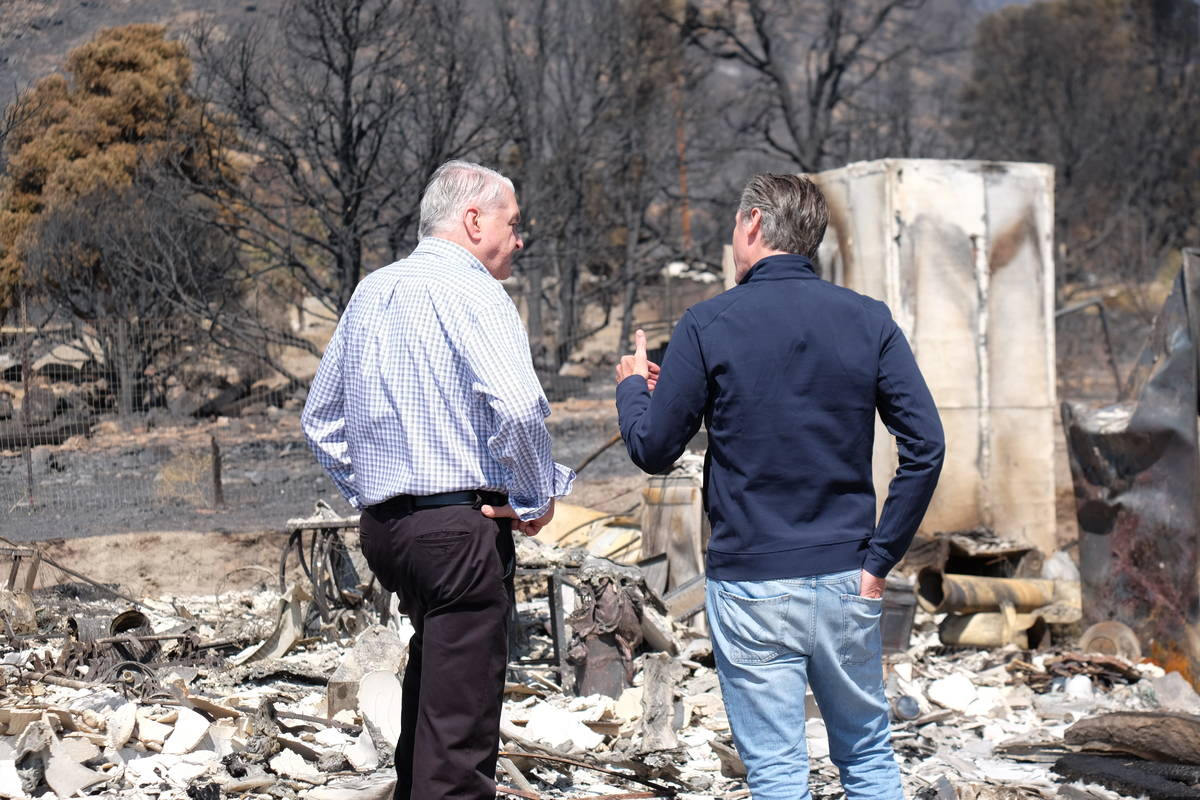 Govs. Sisolak and Newsom look over remains of a home destroyed by fire. July 28, 2021. (Bill De ...