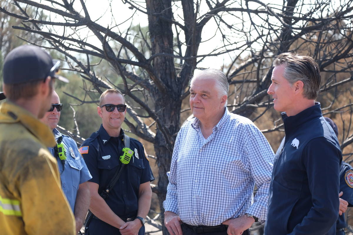 Govs. Sisolak and Newsom speak to fire personnel involved in battling the Tamarack Fire, which ...