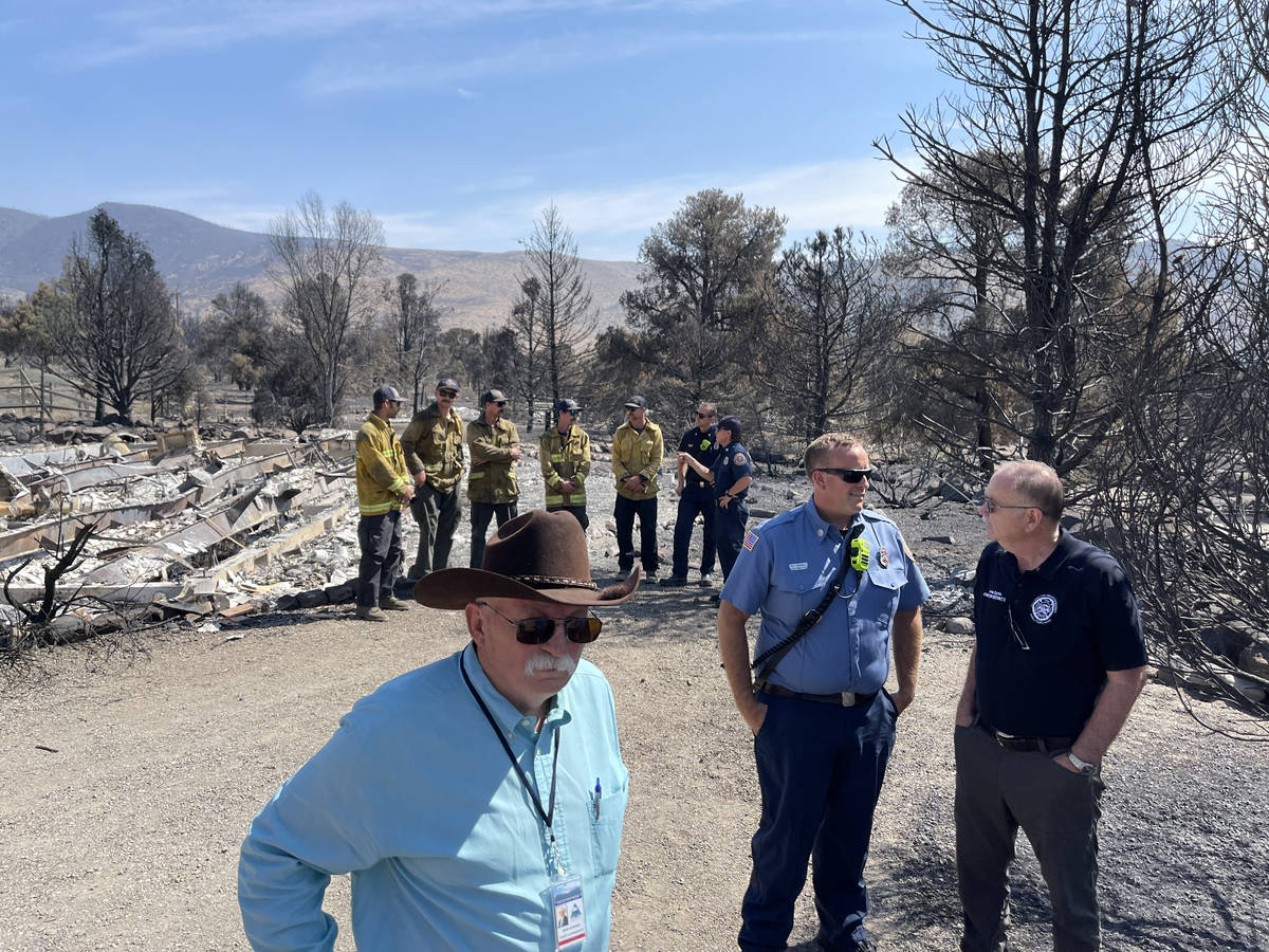 Fire fighters and others at a press briefing by Govs. Newsom and Sisolak. July 28, 2021. (Bill ...