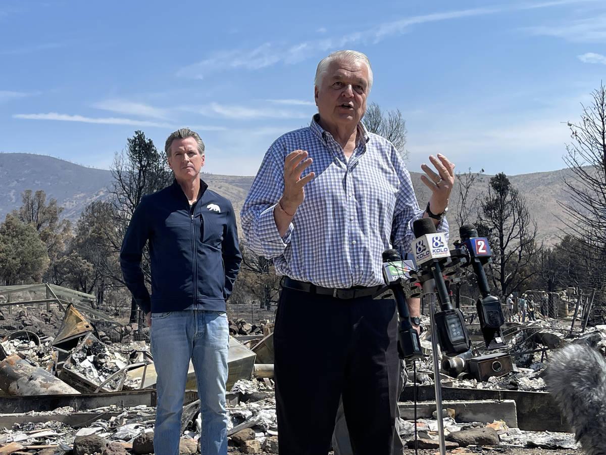 Nevada Gov. Steve Sisolak speaks to reporters Wednesday at the scene of home in Gardnerville, N ...