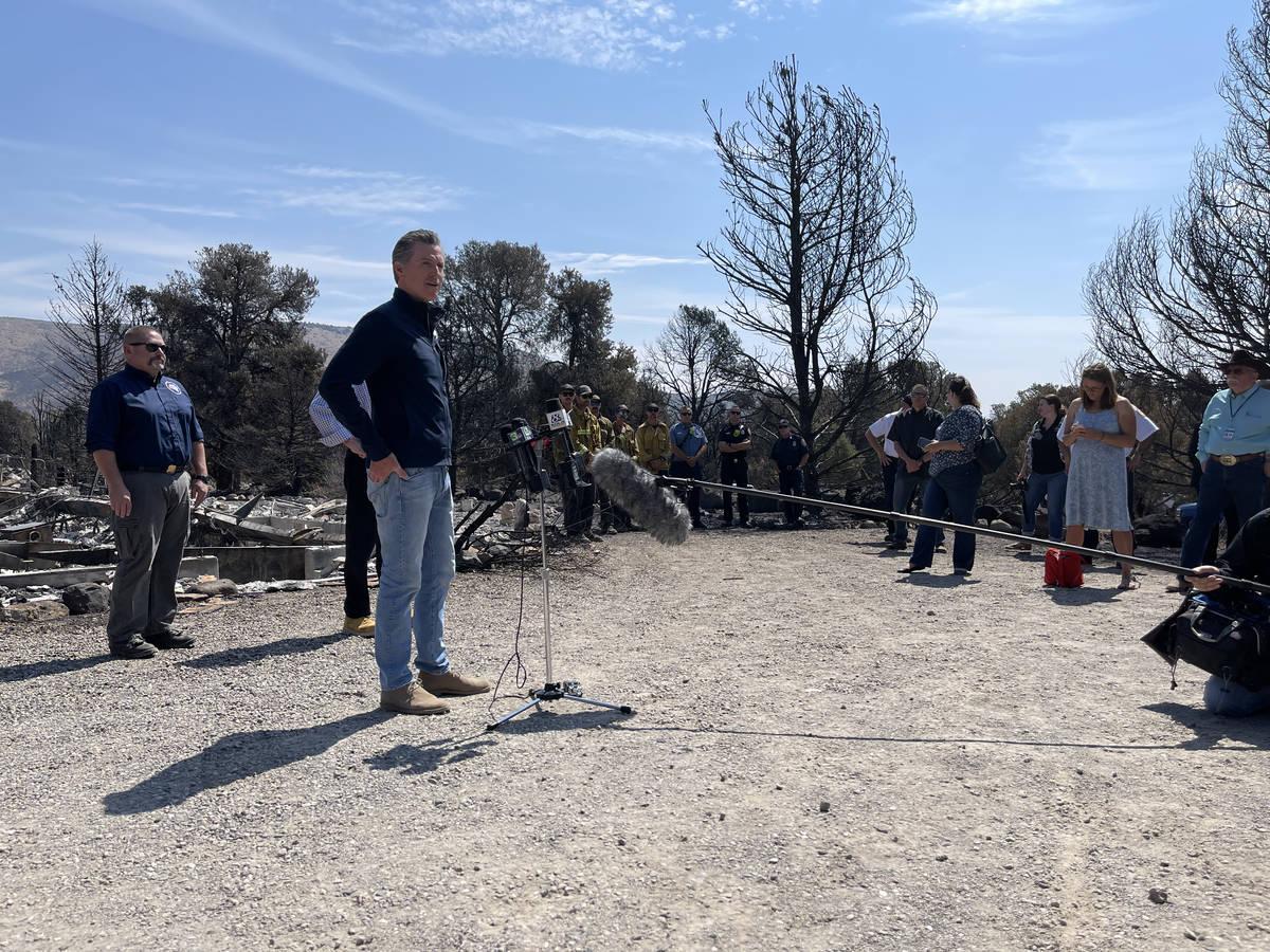 Gov. Gavin Newsom of California speaks to reporters onthe Tamarack Fire. July 28, 2021. (Bill D ...
