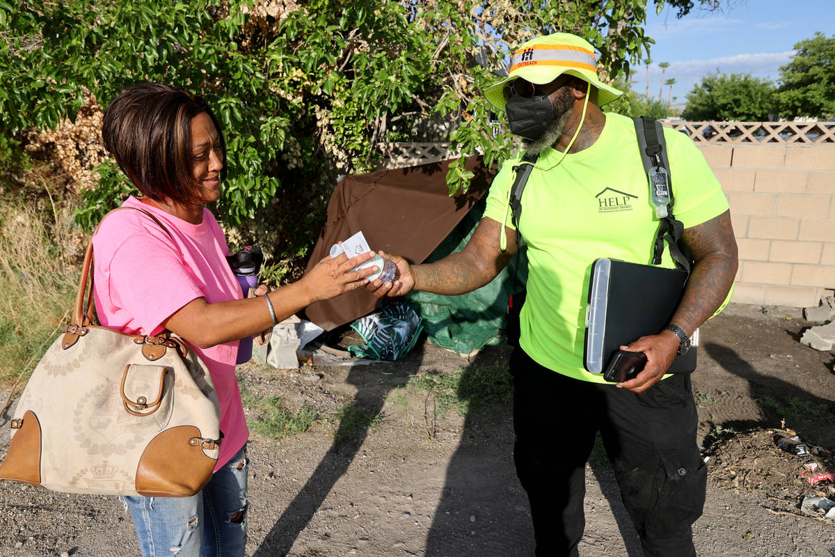 Gerald Jackson, a member of one of HELP of Southern Nevada's Homeless Resource Teams, offers wa ...