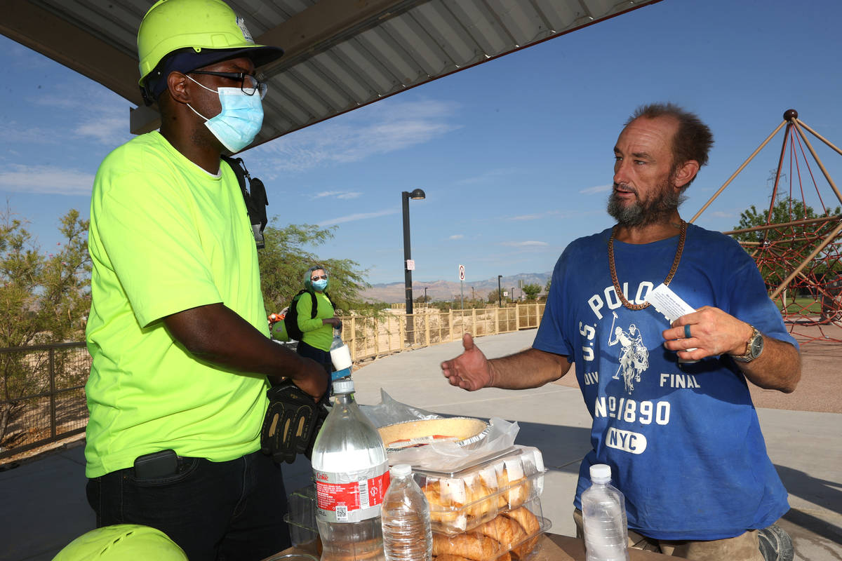 HELP of Southern Nevada outreach worker Eugene Wallace, left, interviews Carl Nickels, 44, duri ...