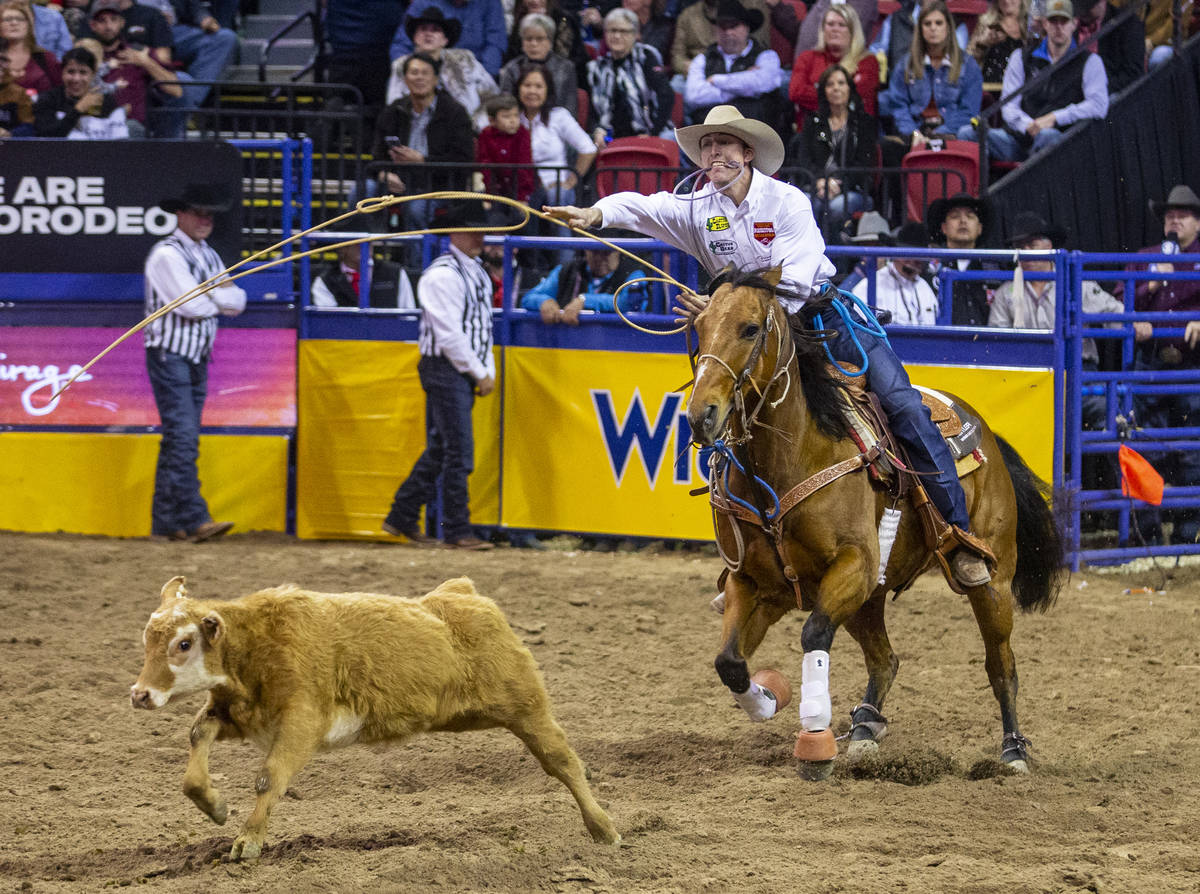 Taylor Santos of Creston, Calif., tosses his lasso in Tie-Down Roping at the tenth go round of ...