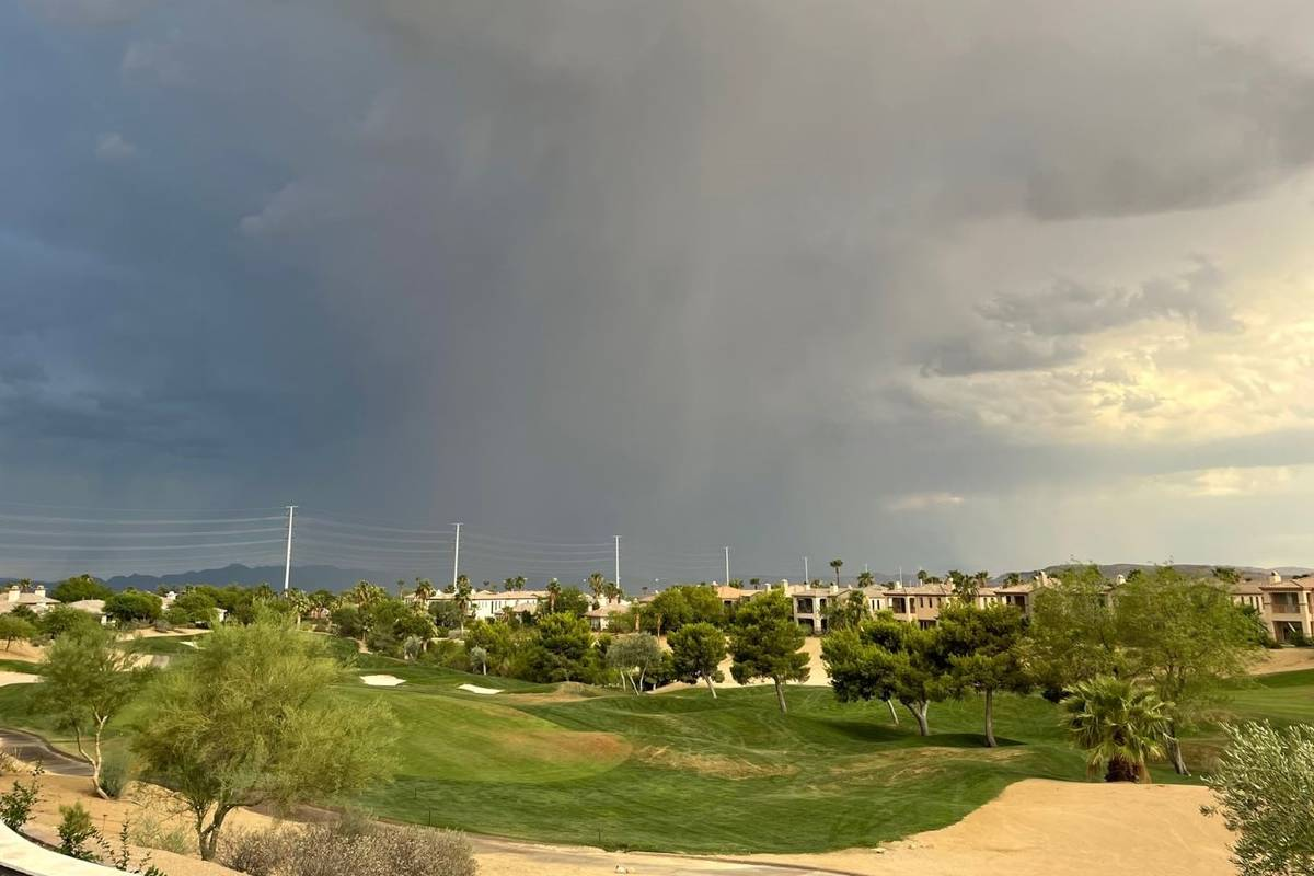 A storm moves into Las Vegas, as seen from the far western valley, on Thursday. (Belinda Englma ...