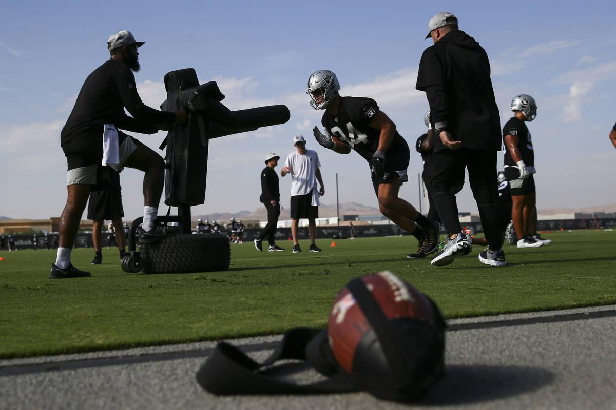 Raiders defensive end Carl Nassib (94) runs through drills during training camp at Raiders Head ...
