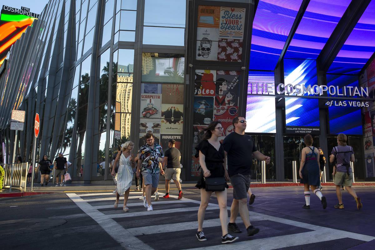 Pedestrians pass the Cosmopolitan of Las Vegas in June 2021. (Ellen Schmidt/Las Vegas Review-Jo ...
