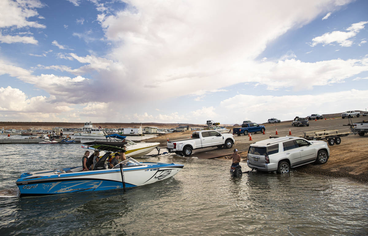 People prepare to take their boats out of the water at the Wahweap main launch ramp at Lake Pow ...