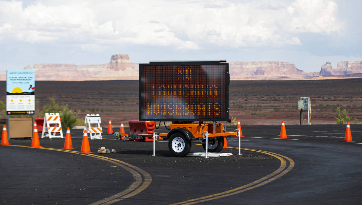 A digital sign informs visitors that houseboats cannot be launched from the Wahweap main launch ...