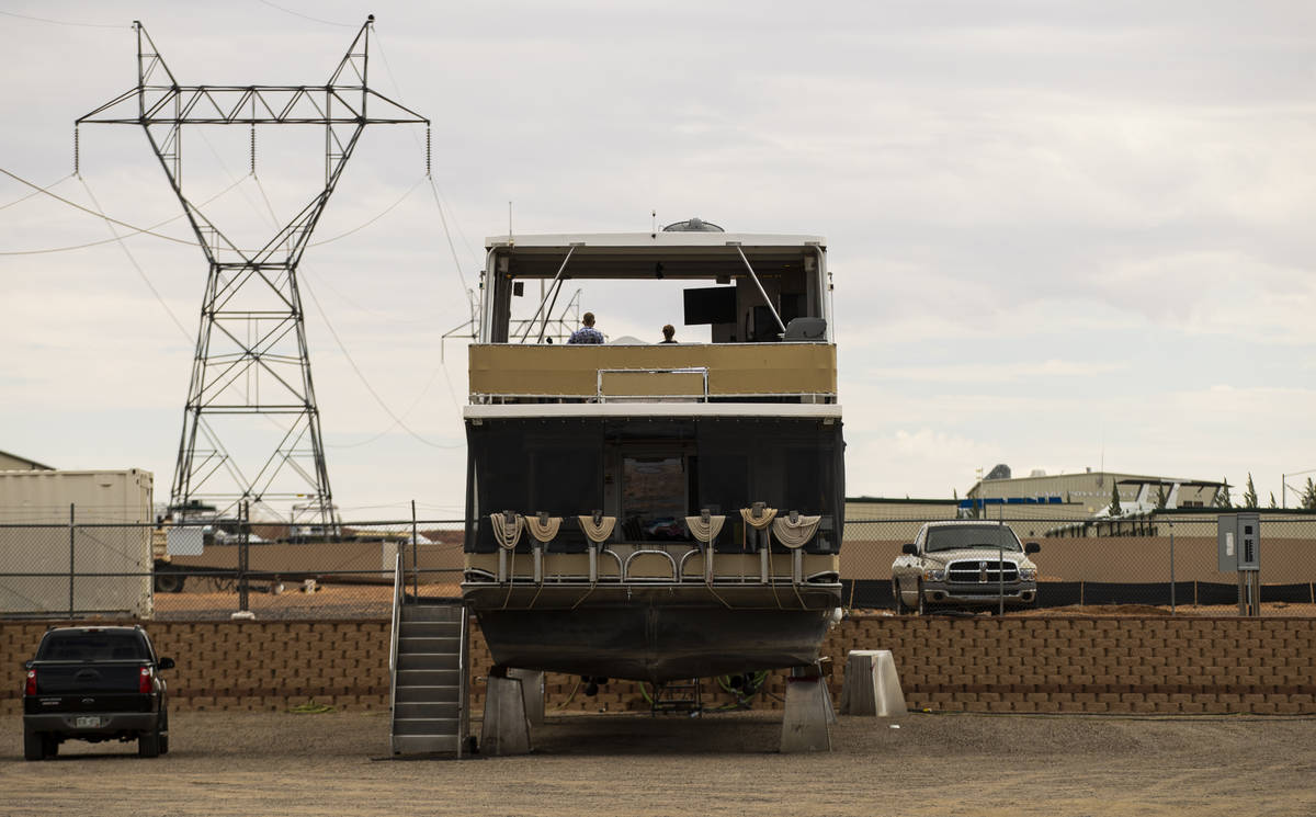 A dry-docked houseboat, which can no longer be launched at the last remaining launch ramp at th ...