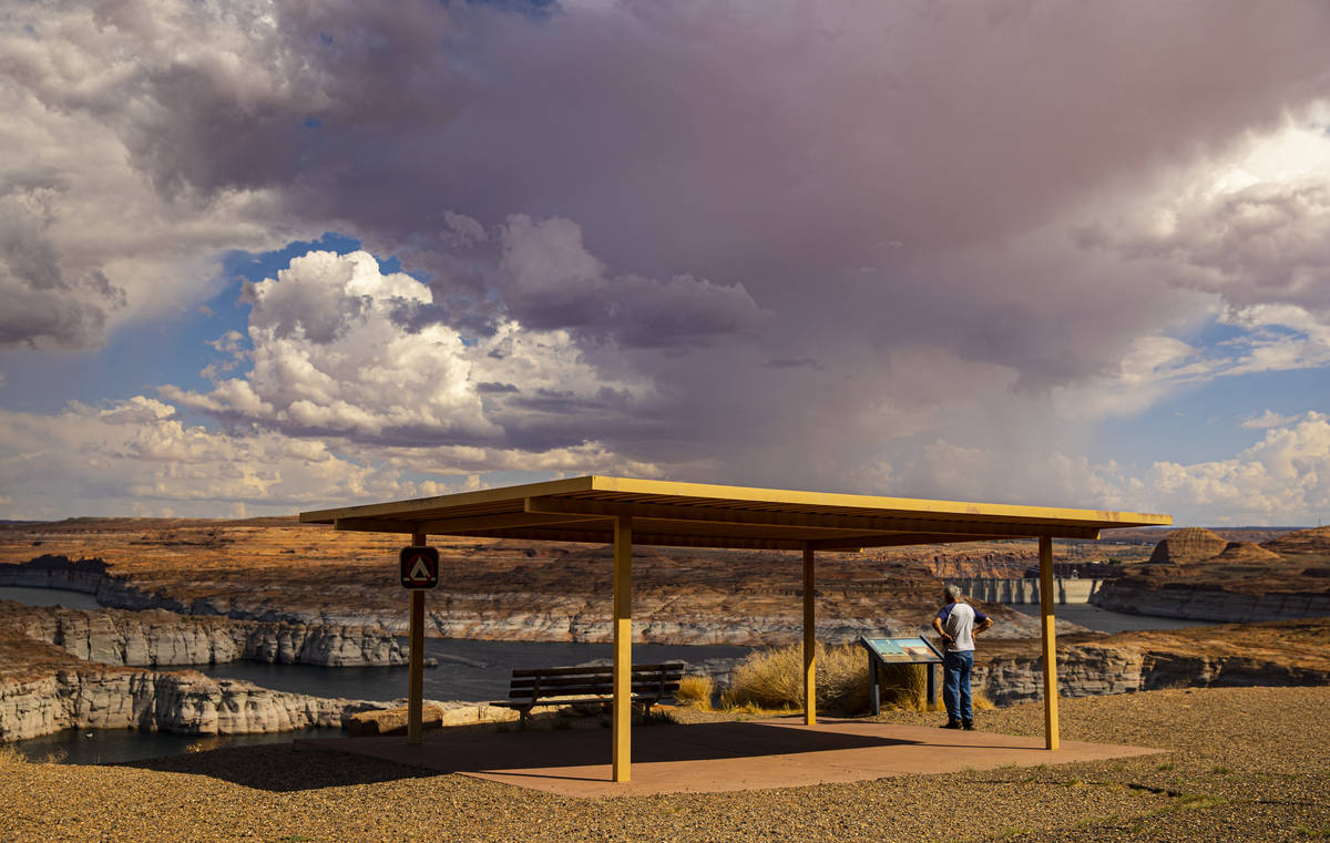 Monsoon clouds are seen from a viewpoint area at Lake Powell in the Glen Canyon National Recrea ...