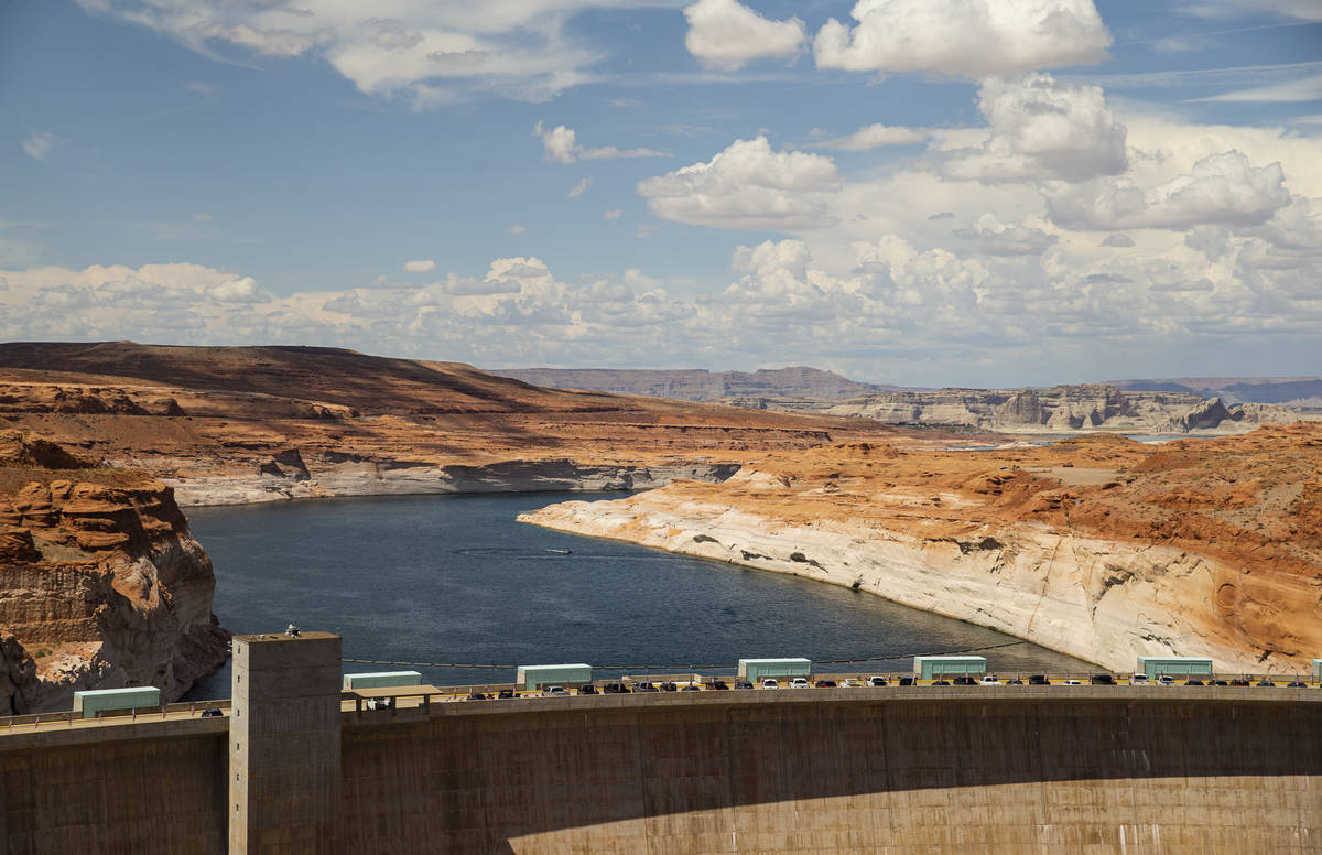 A view of Lake Powell and the Glen Canyon Dam in the Glen Canyon National Recreation Area on Tu ...