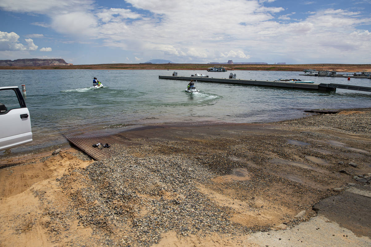 The end of the concrete Wahweap main launch ramp, which is temporarily extended with pipe mats, ...