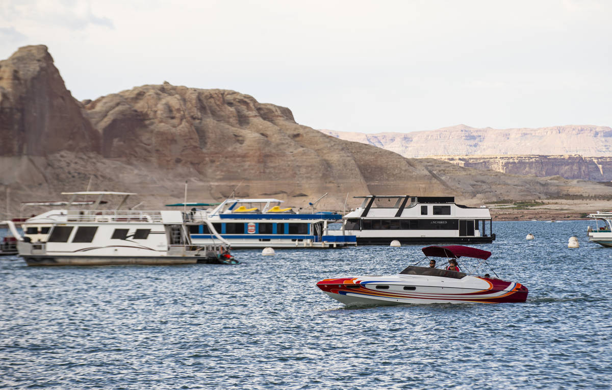 Boats are pictured near the Wahweap Marina at Lake Powell in the Glen Canyon National Recreatio ...