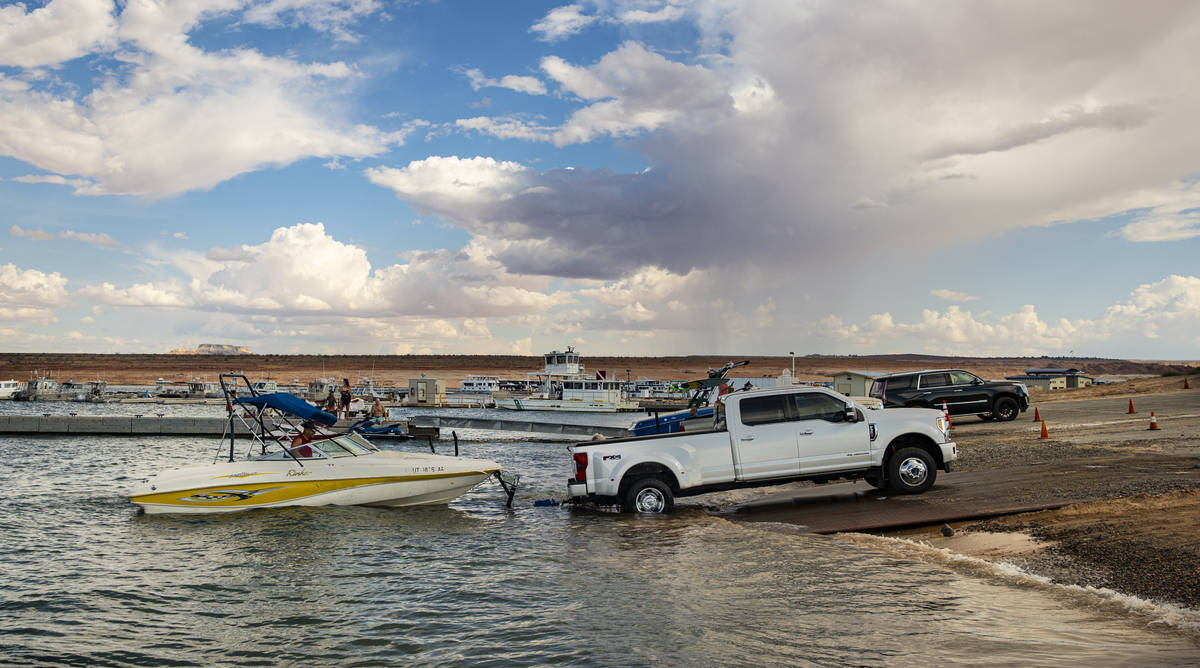Randy Wendt, of Big Water, Utah, prepares to take his boat out of the water at the Wahweap main ...